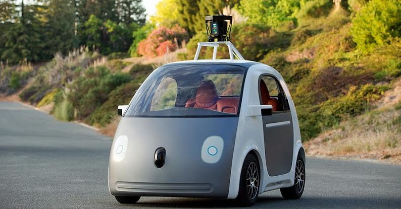 "A ""very early version"" Google's prototype vehicle. The self-driving car doesn't include a steering wheel."