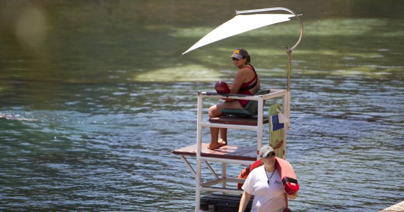 An unidentified lifeguard watches over Barton Springs Pool in this 2011 photo. Austin's aquatic office is hustling to fill several empty lifeguard posts.