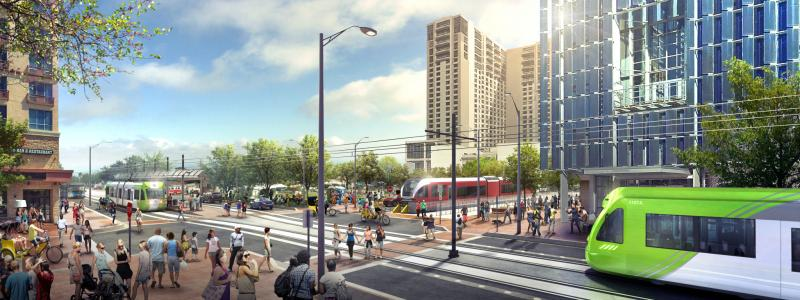 An artist's rendering of an urban rail line intersecting with commuter rail near the Austin Convention Center