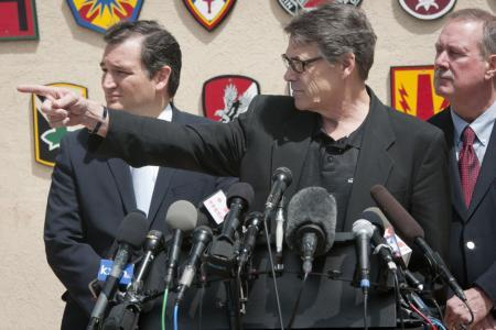 Gov. Rick Perry and Sen. Ted Cruz at an April 2014 news conference at Fort Hood addressing a deadly gunfire incident