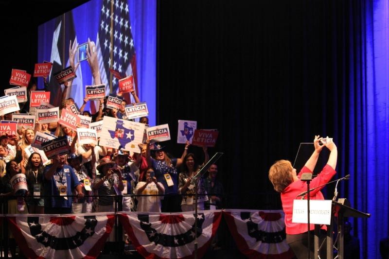 State Sen. Leticia Van de Putte, D-San Antonio, takes a selfie on stage at the Texas Democratic Convention in Dallas on June 27, 2014.