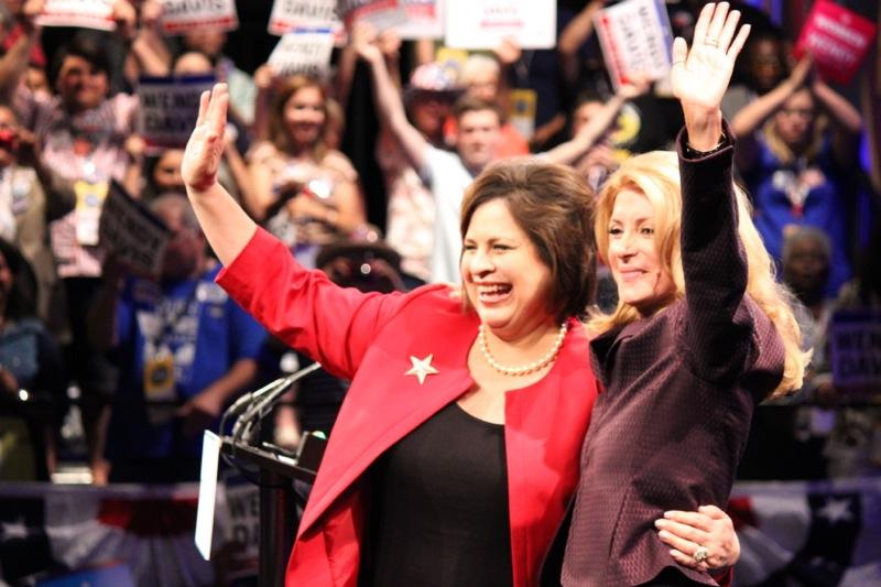 State Sen. Leticia Van de Putte, D-San Antonio, and State Sen. Wendy Davis, D-Fort Worth, wave at Democrats at the Texas Democratic Convention on June 27, 2014.