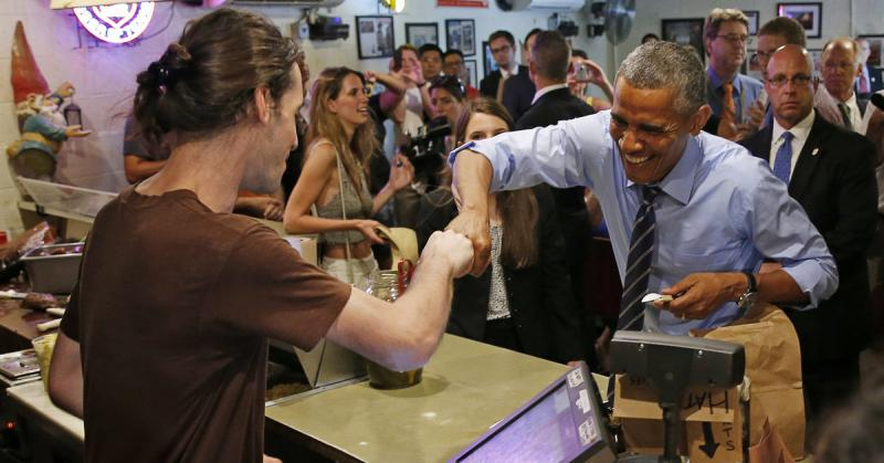 U.S. President Barack Obama fist bumps Daniel Webb at Franklin Barbecue. Webb called for gay equality in his exchange with the president.