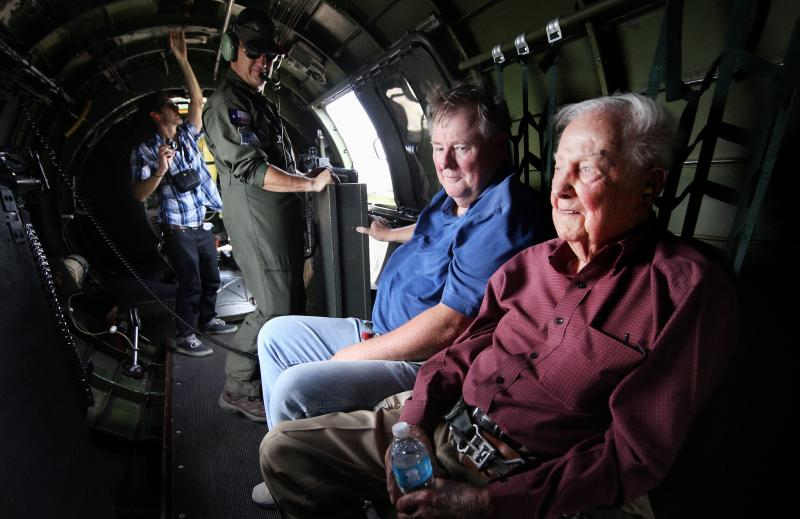 Ed Olson(right), a 96-year-old Georgetown resident and former B-17 instructor and WWII aerial combat veteran flies in a B-17 for the first time in almost 70 years.