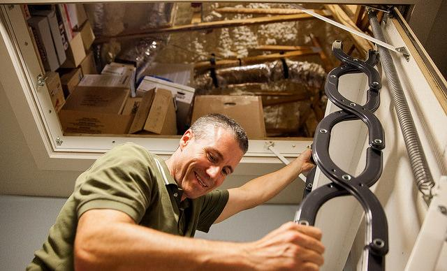 "Steve Bijansky climbs down from the attic of his ""Net Zero"" home in Allandale."