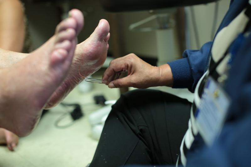 As Debbie Mata examines her new patient, she notices he has lost all feeling in some of his toes. She urges him to start wearing white socks. If he gets hurt and bleeds he won't feel it, but the blood will alert him.