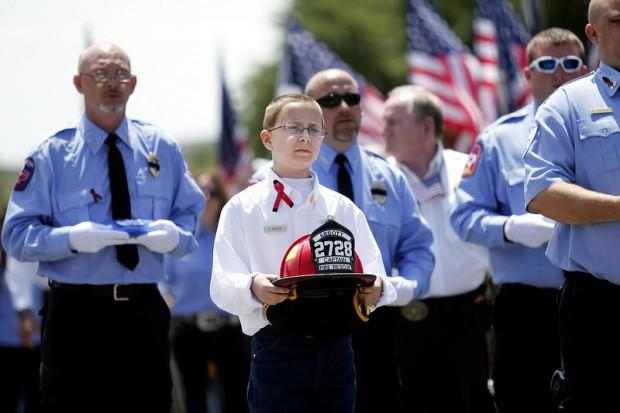A helmet is carried in remembrance of a firefighter from the Abbott Volunteer Fire Department killed in a fertilizer plant explosion in West, Texas last year.