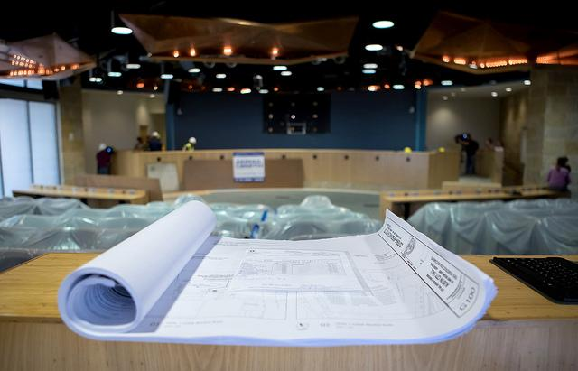 Plans lay in front of the dais as a crew begins renovations on council chambers.