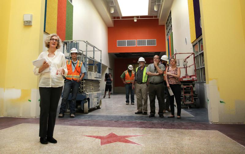 Workers survey Padron Elementary's atrium. In order to ensure every classroom had natural lighting, construction workers added 21 skylights to the building.