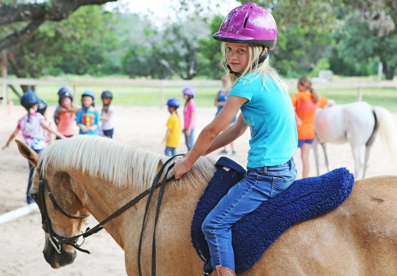 Isabelle DiCarlo rides a horse at Switch Willow. The money her mother Julie spent on activities this summer is around $5,000, which she could write off as a deduction in next year's taxes.