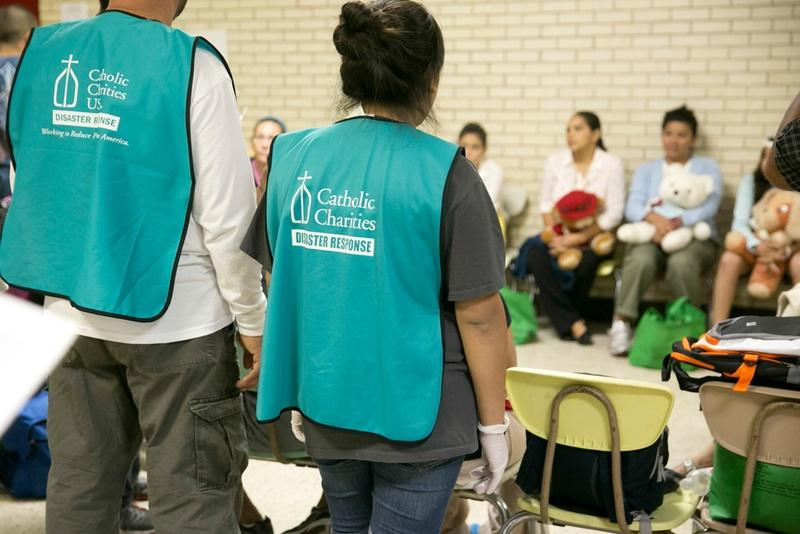 On June 24, 2014, volunteers gather at Sacred Heart Catholic Church in McAllen, where the Rio Grande Valley Catholic Charities have a makeshift shelter to help handle the surge of immigrants who have crossed into the U.S. in recent weeks.