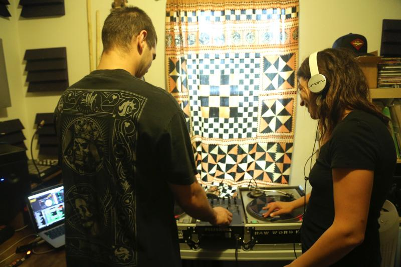 DJ Orión Garcia, left, teaches KUT reporter Veronica Zaragovia what it takes to be a DJ at his home studio in Austin.