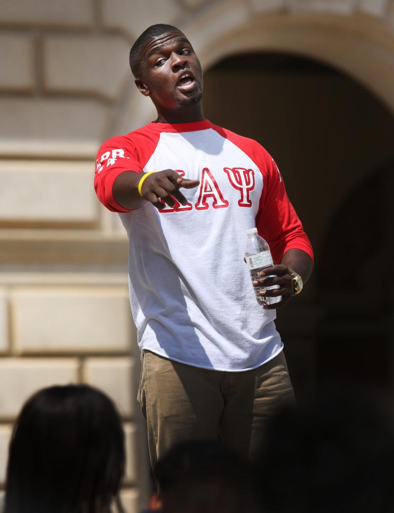 University of Texas student Jarius Sowells gives an impassioned speech to the over one hundred people who turned our for a rally on the south steps of the UT Tower. The rally intended to show support for the people of Ferguson, Mo.