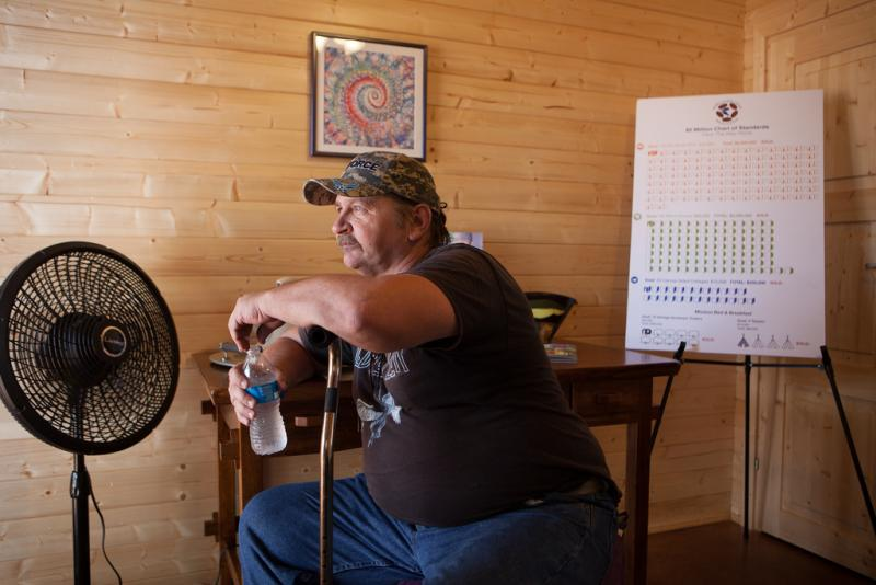 "Kent ""Cisco"" Pruett cools off in front of one of the fans inside a sample micro-home."