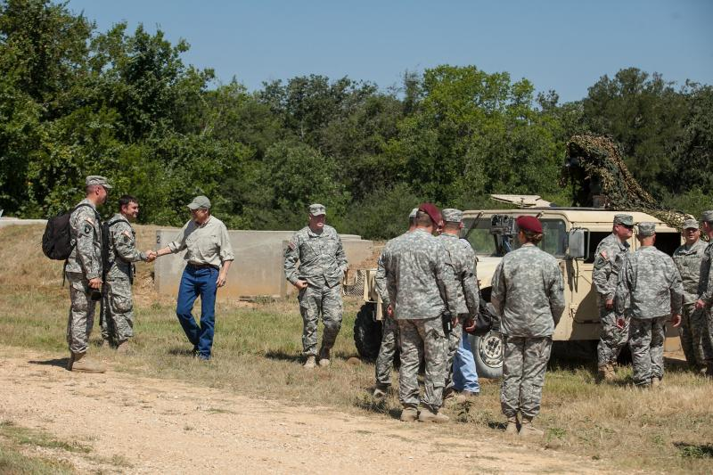 Perry was given a tour of the training grounds by troops.