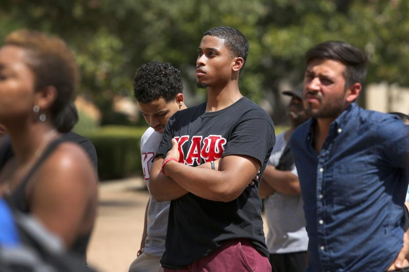Over one hundred people turned our for a rally on the south steps of the UT Tower. Organized by University of Texas students Jarius Sowells and Jasmine Graham the rally was organized to show support for the people of Ferguson, Mo.
