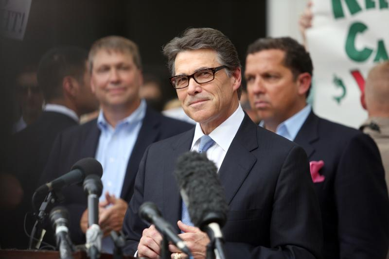Perry speaking outside the Travis County criminal justice center.