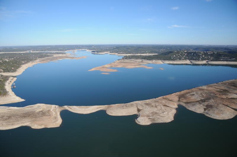 Extreme drought and releases to farmers have lowered levels in Lakes Buchanan and Travis (pictured) in Central Texas. Now a state agency is saying more study is needed into how the reservoirs are managed.