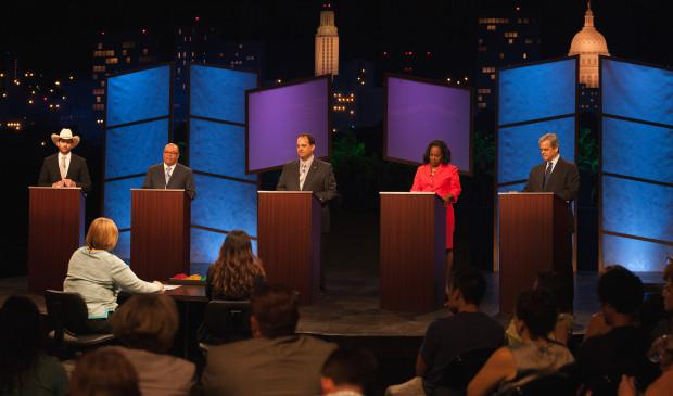 KUT's Jennifer Stayton moderated the panel of five mayoral hopefuls at KLRU's forum.
