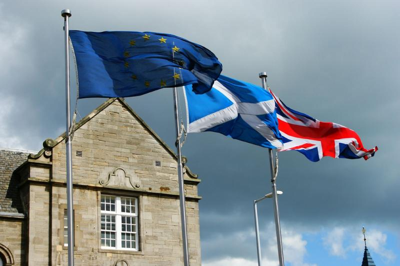 The European Union, Scottish and Union Jack flags fly in this 2009 photo. On September 18, Scottish voters will decide their fate: whether to remain part of the United Kingdom, or to move toward independence.