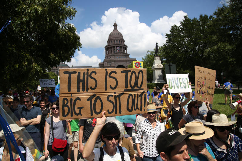 Activists marched from the Capitol, down Congress Avenue and back in support of climate change awareness.