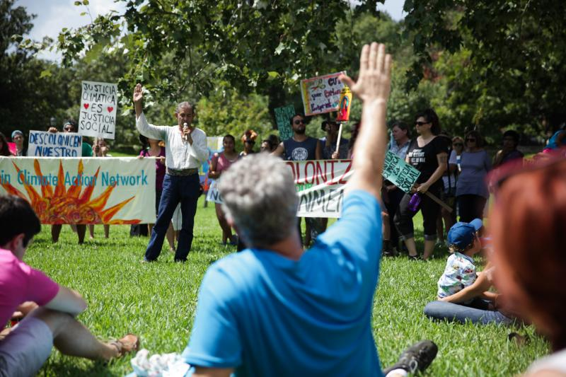 Demonstrators gathered on the lawn outside the Capitol.