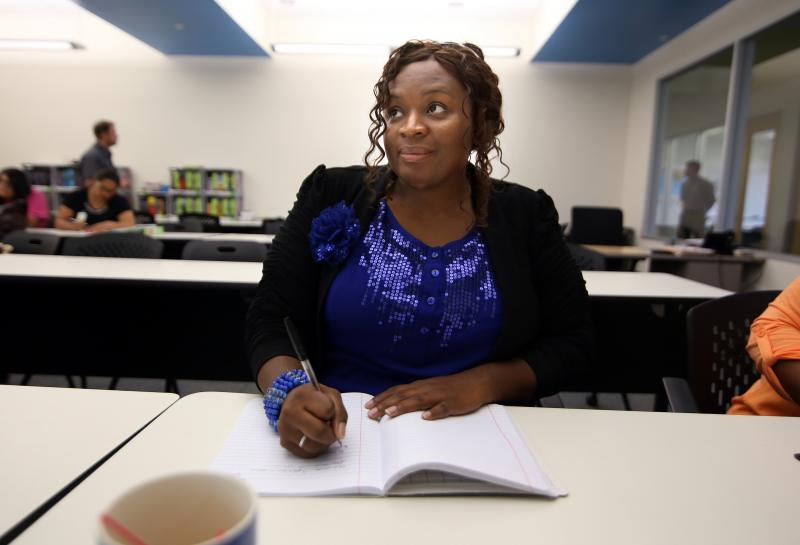 Georgina Hudson takes notes during class at the Goodwill Excel Center. The school is the first free public charter school for adults ages 19-50 in Texas. It's goal is to provide adults the opportunity and support to earn a high school diploma and post-sec