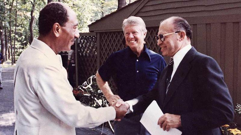 Egyptian President Anwar Sadat, U.S. President Jimmy Carter and Israeli Prime Minister Menachem Begin at Camp David in 1978. The Middle Eastern peace agreement that emerged from the meeting is the subject of journalist Lawrence Wright's new book.