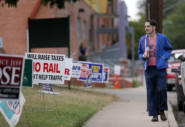 East Austin resident Michael Reust leaves the Pan American Center after casting his vote.