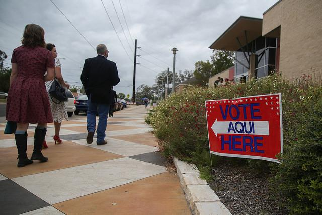 Austin residents gather to vote at the Austin Public Library, George Washington Carver Branch on Angelina Street on Tuesday.