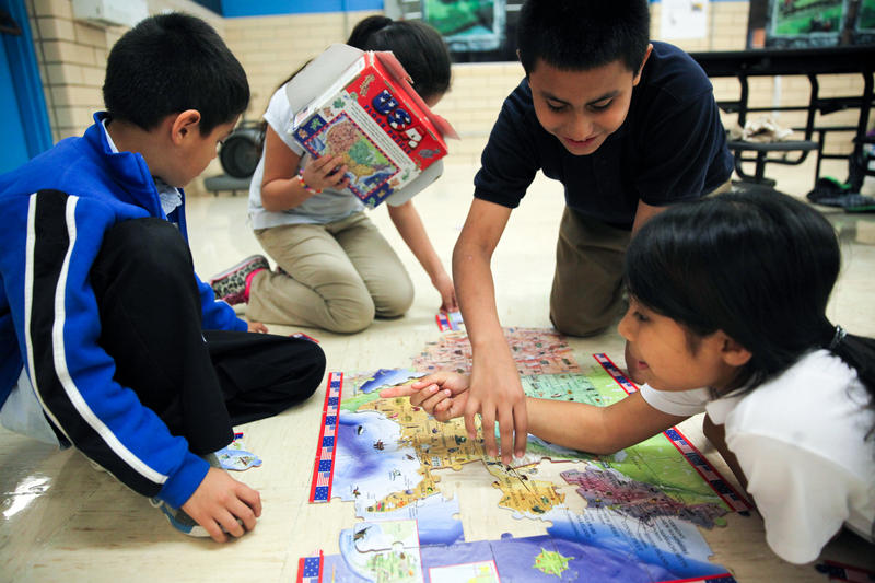 Students at Pecan Springs work out a puzzle at the after school program organized by the Andy Roddick Foundation. The Foundation gave $160,000 for the program which provides structure and after school activities to students after federal funding dried up.