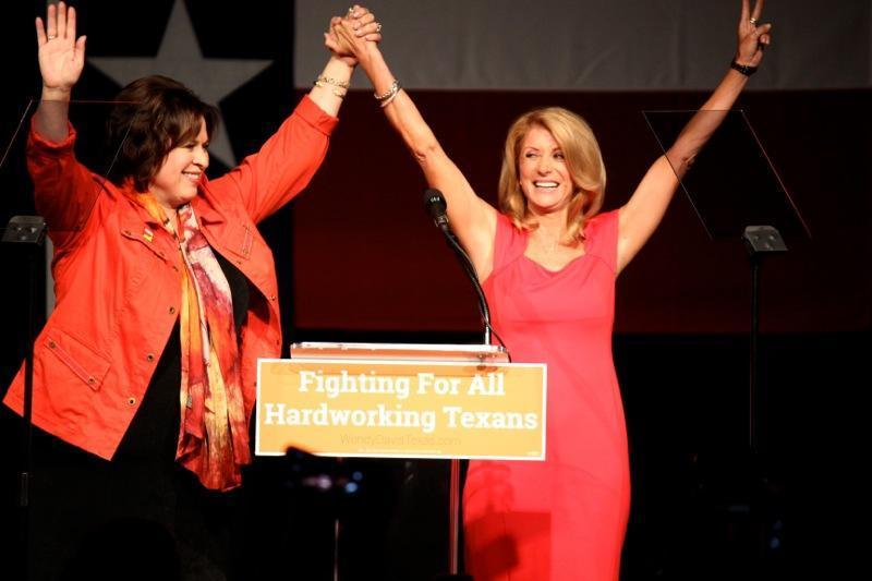 State Sen. Leticia Van de Putte, D-San Antonio, left, and State Sen. Wendy Davis, D-Fort Worth, spoke to supporters on June 25, 2014, the one-year anniversary of Sen. Davis's filibuster.