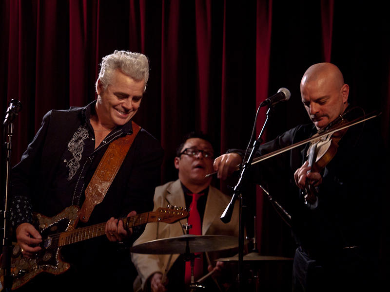 Dale Watson performing with his band at the Cactus Cafe in 2011