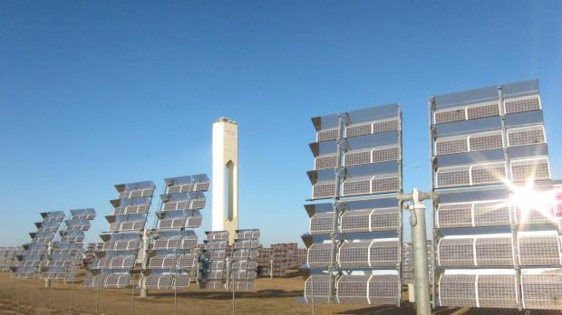 Photovoltaic solar panels (foreground) with the PS10 concentrated solar tower in the background at the Abengoa Solucar complex outside of Sevilla, Spain.