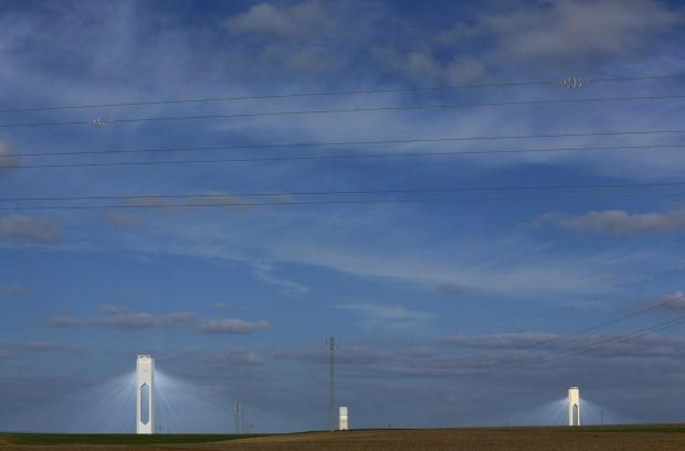 """Towers at Abengoa solar plant at """"Solucar"""" solar park are seen in Sanlucar la Mayor, near the Andalusian capital of Seville"""