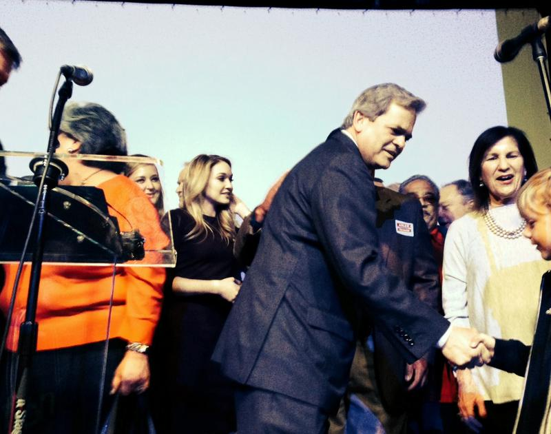 Mayor-elect Steve Adler shakes a young supporters hand at his Election Night party.
