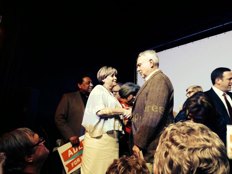 Adler's wife Diane Land shakes hands with Mayor Lee Leffingwell.