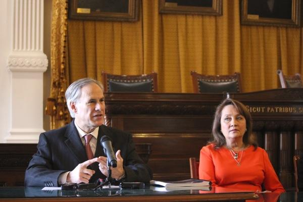 Attorney General Greg Abbott, seated next to his wife, Cecilia Abbott, lists his priorities for his term in office as future governor of Texas.