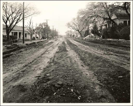 A shot of Lamar Boulevard before it was paved, looking south at Ninth Street.
