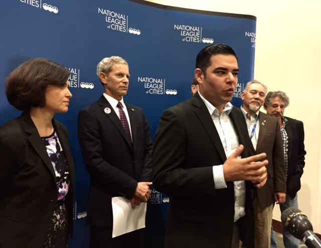Long Beach, Calif., Mayor Robert Garcia, center, joins a group of mayors at the Austin Convention Center to speak out in support of President Barack Obama's executive action on immigration on Nov. 21, 2014.