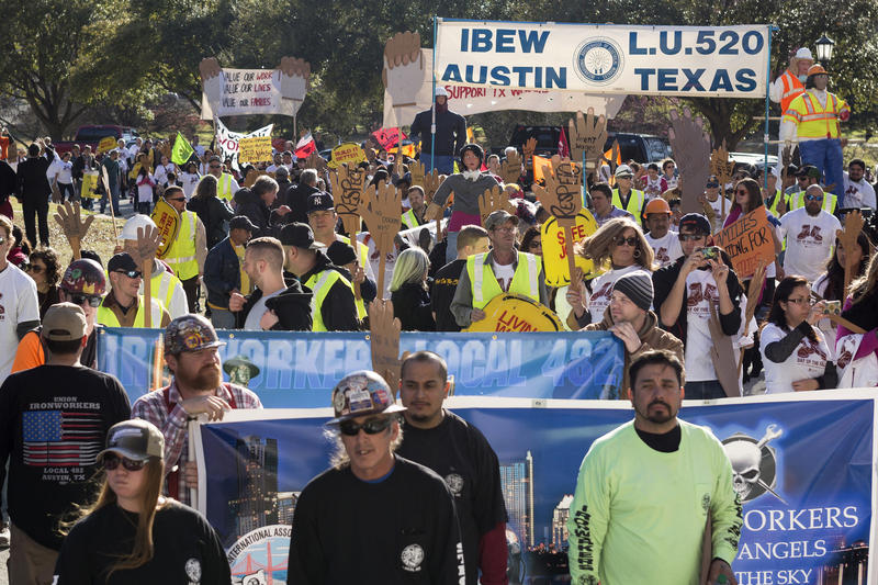 Workers rights supporters march towards the Texas State Capitol.