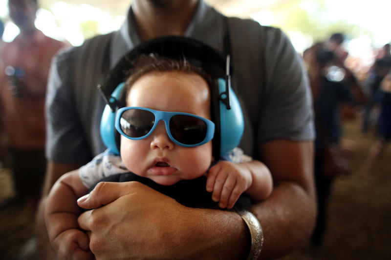 Austinite Kingston Arbor, 3 months old, hangs with his father Ryan Arbor at an Austin music festival in 2013.