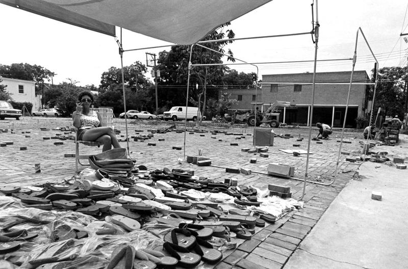 An unnamed vendor sells sandals at the Renaissance Market off Guadalupe in the 1970s.