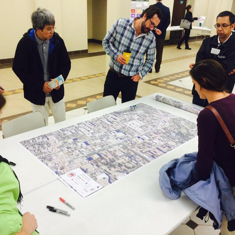 At a recent open house on how to improve the Guadalupe corridor, known as 'The Drag,' attendees annotated large maps with their ideas and concerns.