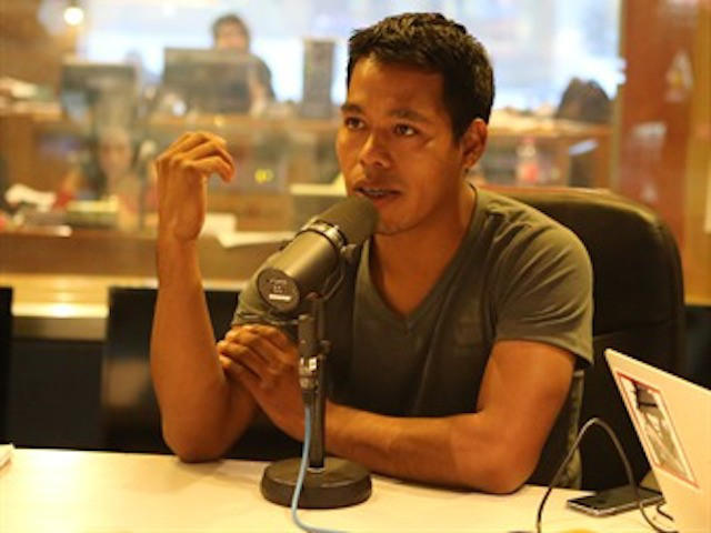 Omar Garcia Velazquez, 24, a student survivor, gives an interview with Mexico's W Radio.