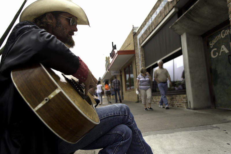 James Anthony Johnson performs on South Congress. Johnson, originally from Tennessee, has been playing local venues and busking for over 20 years in Austin.