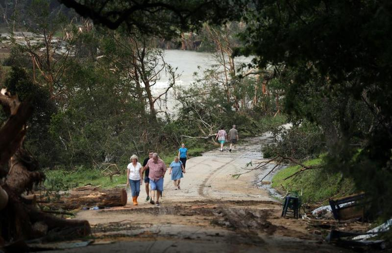 Wimberley residents walk and survey the town after Monday's storms.