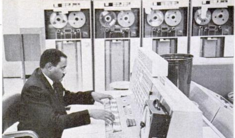 Clyde Foster processes telemetry at the Marshall Space Flight Center in 1965 in a photo that appeared in Ebony magazine. As a NASA employee, Foster was a leader in getting jobs and advancing engineering education for African Americans.