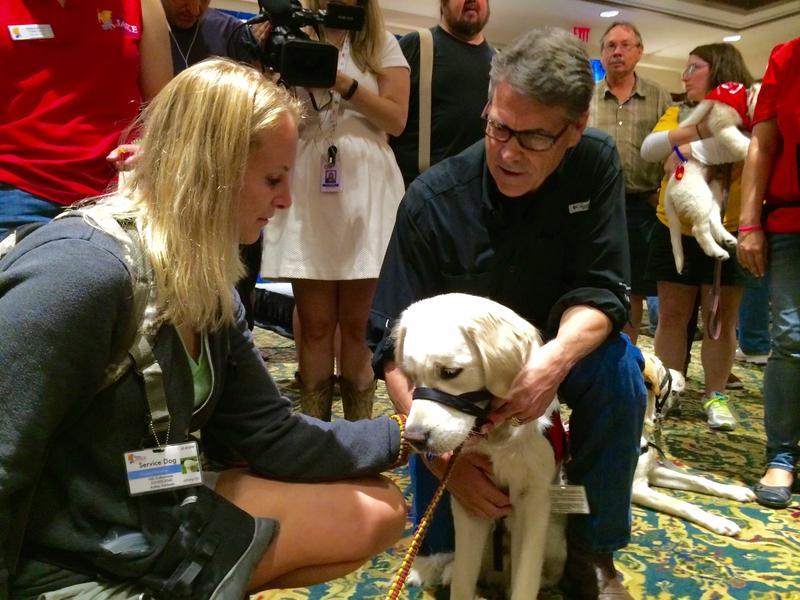 RIck Perry meets a service dog and its trainer at Hotel Pattee in Perry, IA.