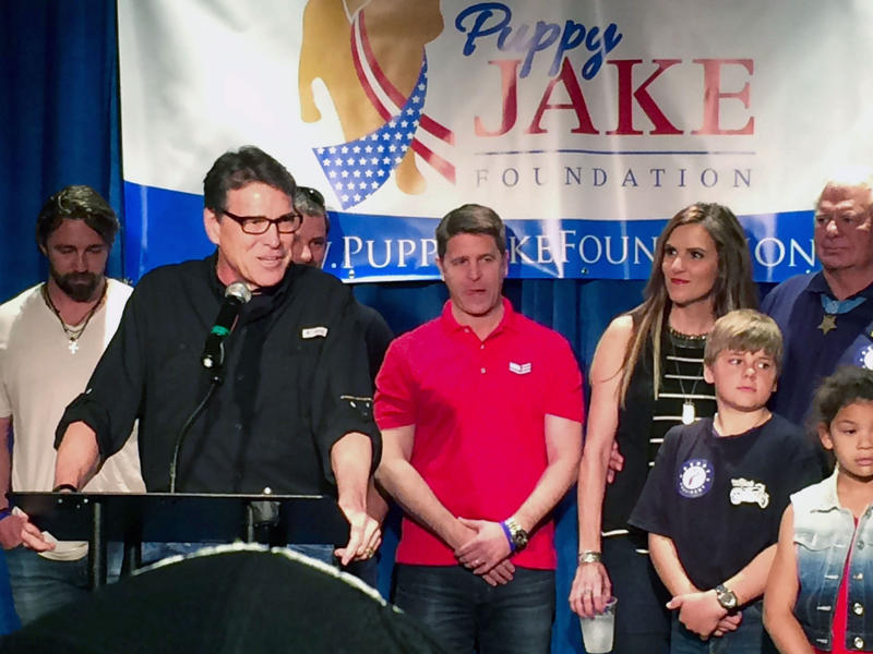 Rick Perry speaks to a crowd at Hotel Pattee in Perry, IA
